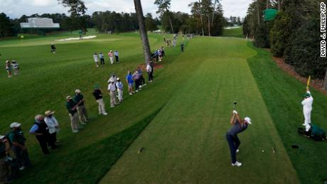 Johnson tees off on the 18th hole.