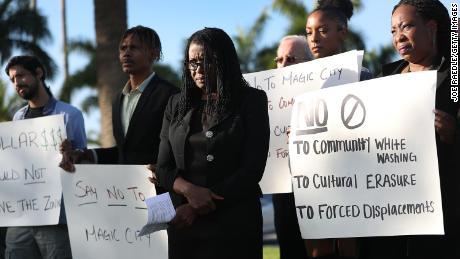 Marleine Bastien, center, protests with residents and activists against the Magic City plans.