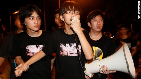 Joshua Wong  speaks to tens of thousands protesters outside government headquarters in Hong Kong, Saturday, Sept. 8, 2012.