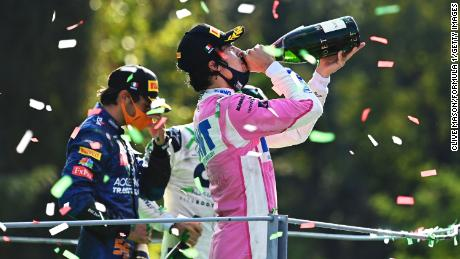 Lance Stroll (right) celebrates on the podium at this year's Italian GP.