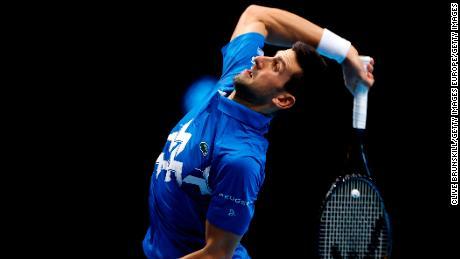 Djokovic serves during his match against Thiem.