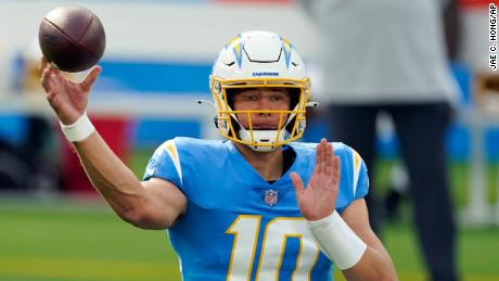 Many had seen the battle for the Offensive Rookie of the Year award as a straight shoot-out between Burrow and the LA Chargers' Justin Herbert (pictured).