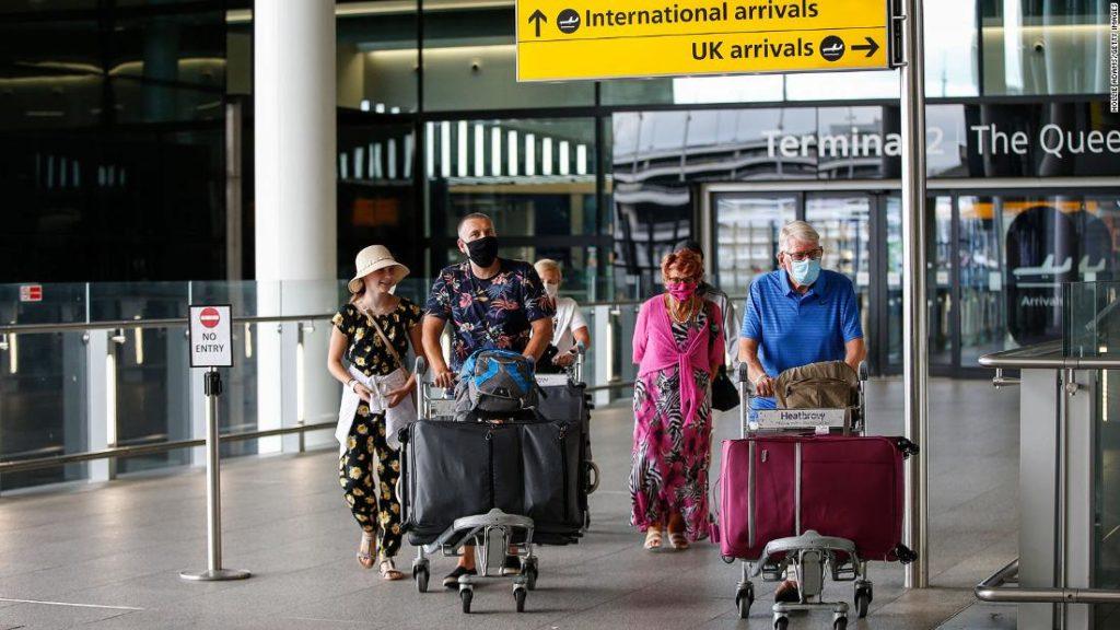 England cuts traveler quarantine period to five days