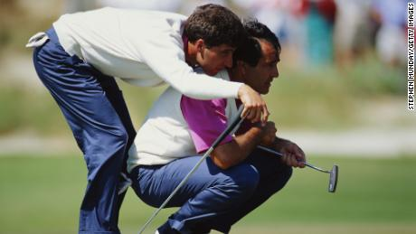 Olazabal uses the shoulders of Ballesteros to get a better view of the hole during the 29th Ryder Cup in 1991.