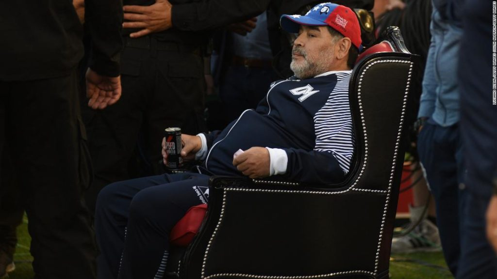 Diego Maradona receives hero's welcome -- and a throne -- on return to former club