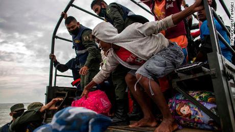 Navy members help evacuate people from the Karata and Wawa Bar communities ahead of the arrival of Hurricane Iota in Bilwi, Puerto Cabezas, Nicaragua Sunday.