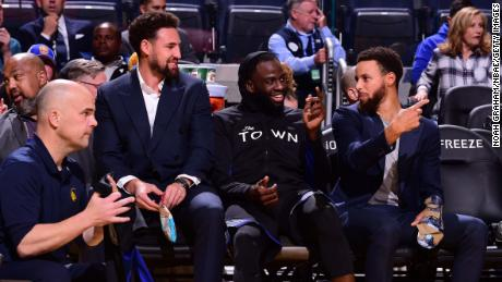 Thompson, Draymond Green and Steph Curry (l-r) will not play together until at least the 2021-22 NBA season.