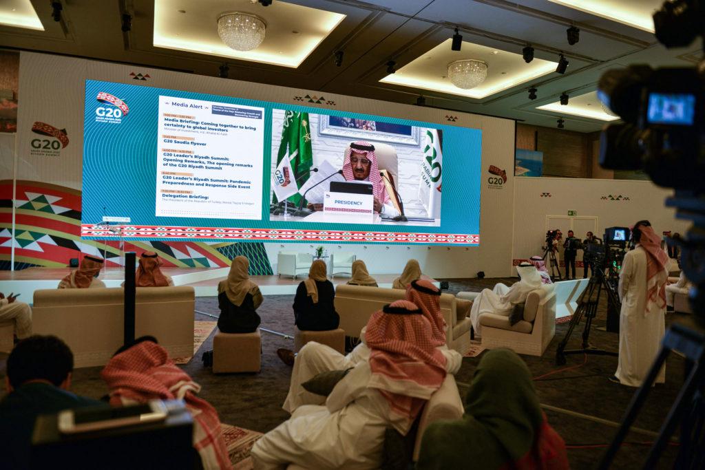 Members of the media watch on a projected screen at the International Media Centre in Saudi Arabia's capital Riyadh as Saudi King Salman bin Abdulaziz gives an address opening the G20 summit on November 21.
