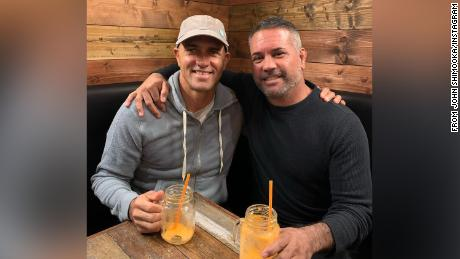 Shimooka (right) poses for a photo with Kelly Slater.