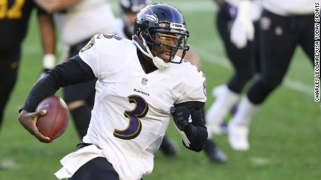 Baltimore Ravens quarterback Robert Griffin III rushes the ball against the Pittsburgh Steelers.