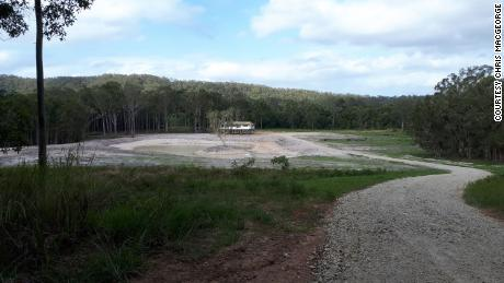 The house now sits a long way from any main roads. Surrounded by bushland, it'll look out onto a lake, where guests can take a boat to a small island.