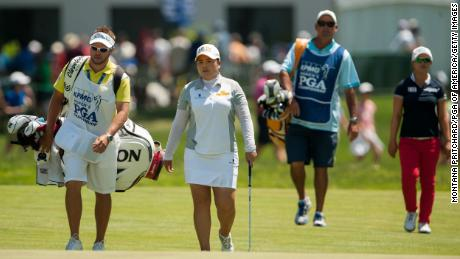 Inbee Park (second left) and her caddie walk down the fairway with  Kim (right) and her caddie during the final round of the 2015 Women's PGA Championship.
