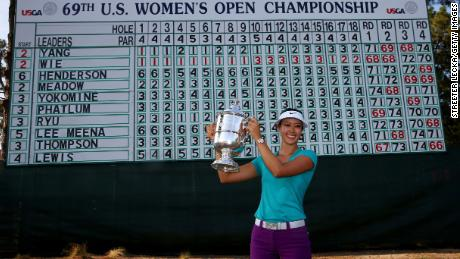Wie celebrates with the trophy after winning in the final round of the 69th U.S. Women's Open in 2014.