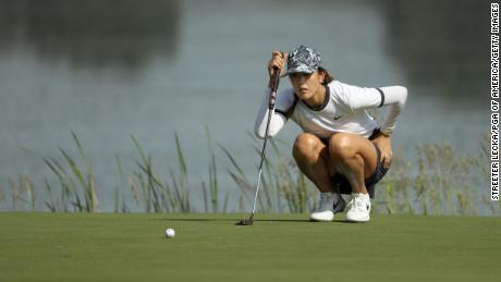 Wie lines up a putt on the 10th green during the first round of the PGA Championship.
