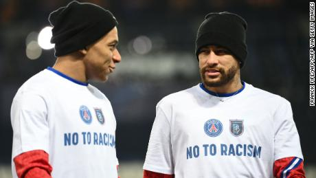 Players and coaching staff wore t-shirts with the message 'NO TO RACISM.'