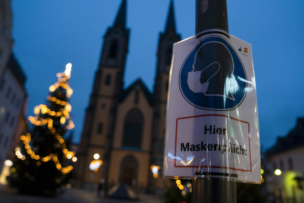A sign reminding people that masks are required in Hof, Bavaria is seen in front of the St. Marien church on December 10.