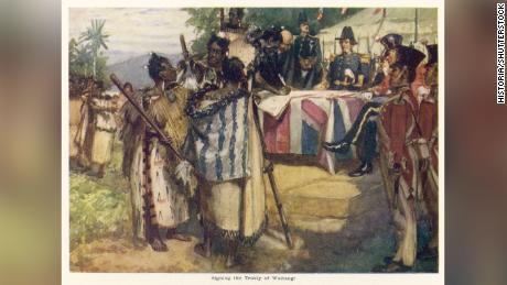 Photo by Historia/Shutterstock. Māori chiefs sign the Treaty of Waitangi in New Zealand on  February 6, 1840.