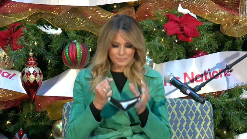 Melania Trump breaks children's hospital rules by taking her mask off to read to patients