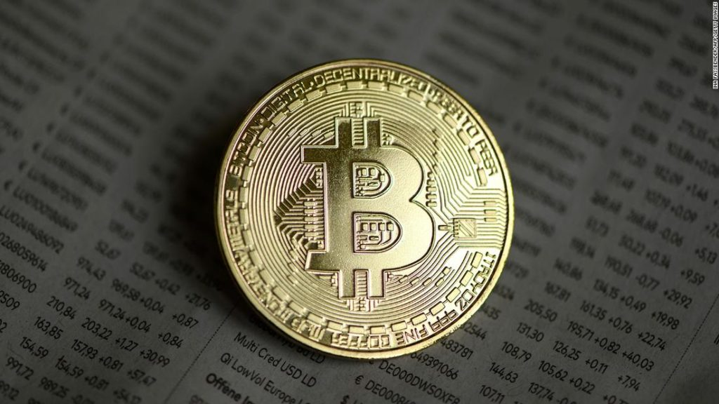 Bitcoin prices top $20,000 milestone and continue to surge to record highs