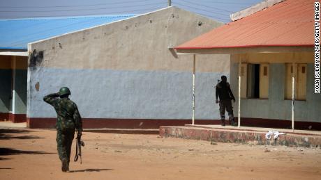 Nigerian soldiers walk inside the school on December 15, where gunmen abducted students in Kankara, Nigeria.
