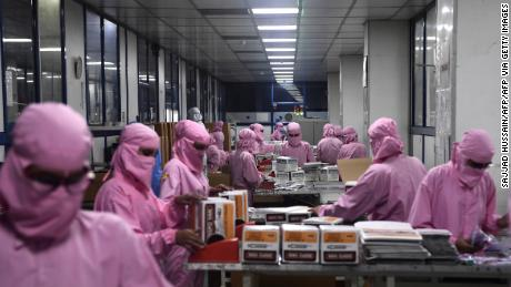 Workers pack syringes at the Hindustan Syringes factory, India's biggest syringe manufacturer, is ramping up production to churn out a billion units, anticipating a surge in demand.