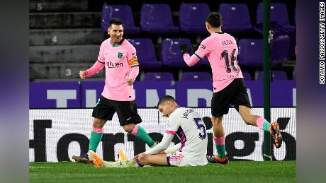 Messi celebrates with Pedri after scoring against Real Valladolid.