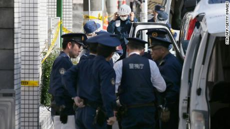 Policemen prepare for inspection in front of an apartment in Zama, Kanagawa prefecture, on November 2, 2017, where police found nine dismembered corpses.