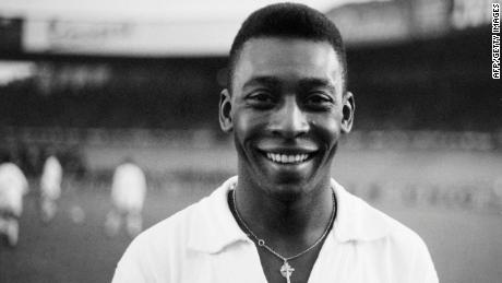 Brazilian striker Pelé, wearing his Santos jersey, smiles before playing a friendly match in 1961.