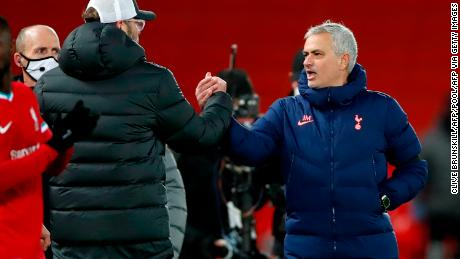 Jurgen Klopp shakes hands and exchanges words with Jose Mourinho after the match.