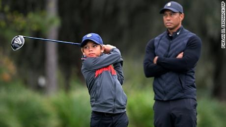 Tiger Woods watches as his son Charlie tees off.