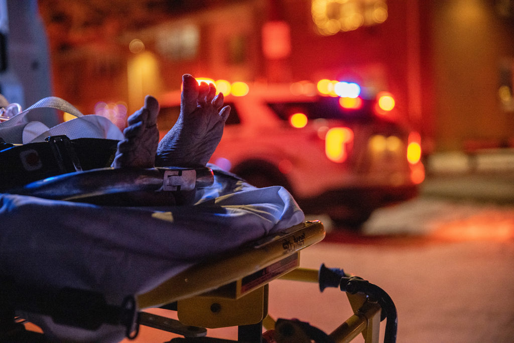 A woman, 70, with possible Covid-19 symptoms and pre-existing conditions is rushed to a hospital by Empress EMS on December 17, in Yonkers, New York.