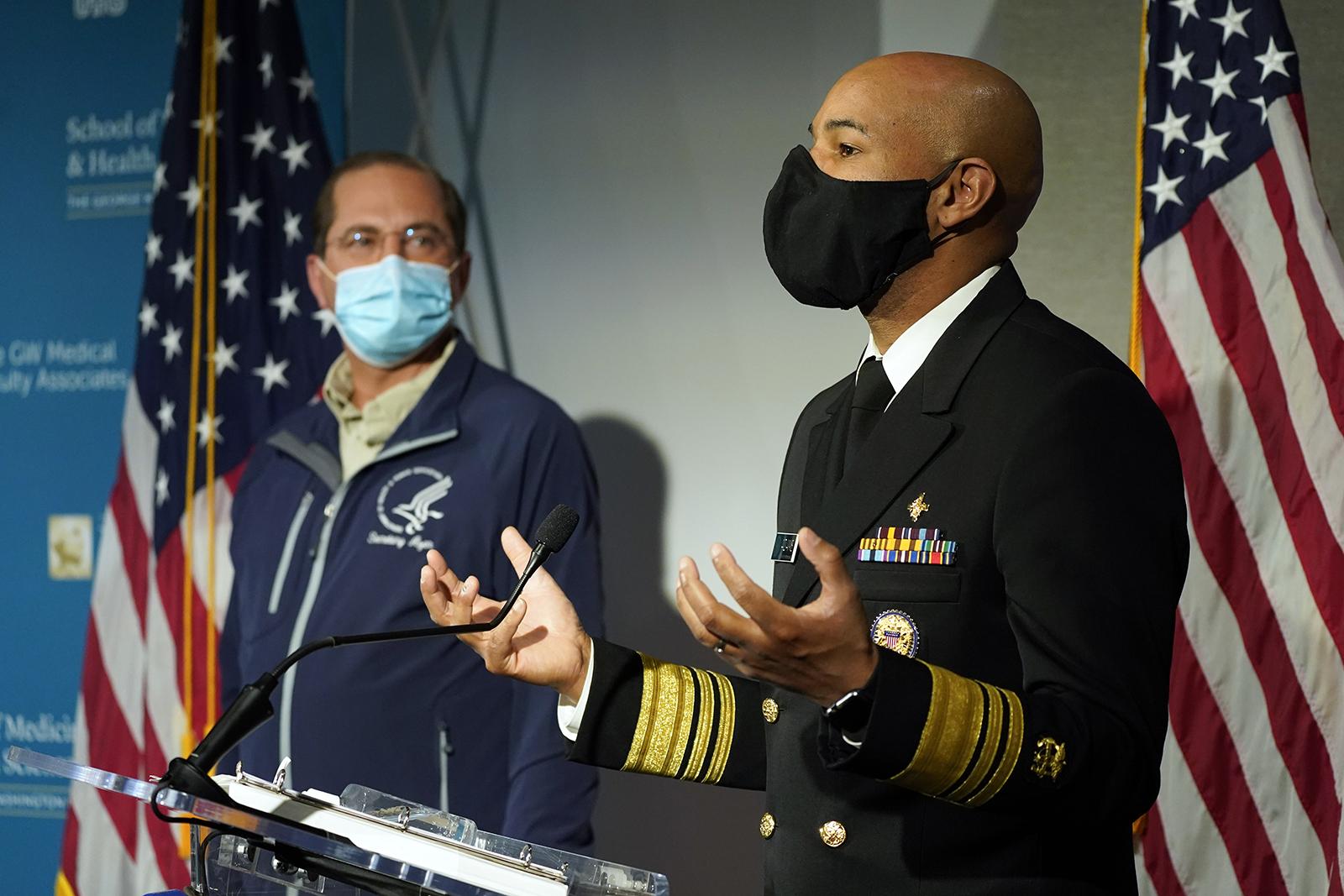 U.S. Surgeon General Dr. Jerome Adams speaks at George Washington University Hospital on Monday, December 14, in Washington.