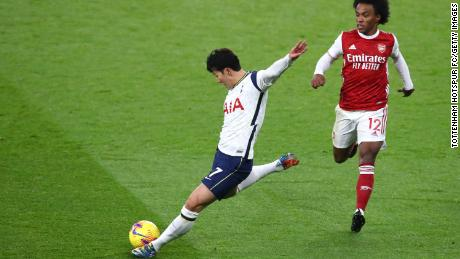 Son scores whilst under pressure from Willian against Arsenal.
