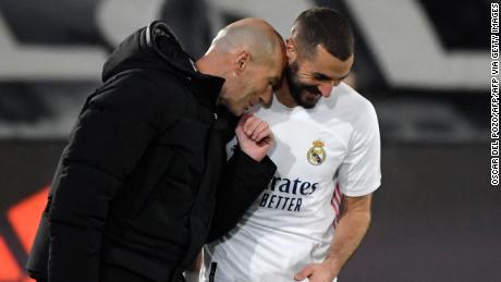 Karim Benzema celebrates with Zinedine Zidane after scoring against Athletic Bilbao.