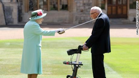 Queen knights 100-year-old veteran Captain Tom Moore, who raised millions for NHS