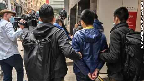 District councilor Ben Chung led away by police in Hong Kong. Chung was one of dozens of pro-democracy activists and politicians arrested on January 6, 2020.
