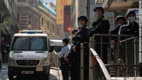 Police seen in downtown Hong Kong on January 6, 2021, as dozens of opposition figures are arrested across the city.