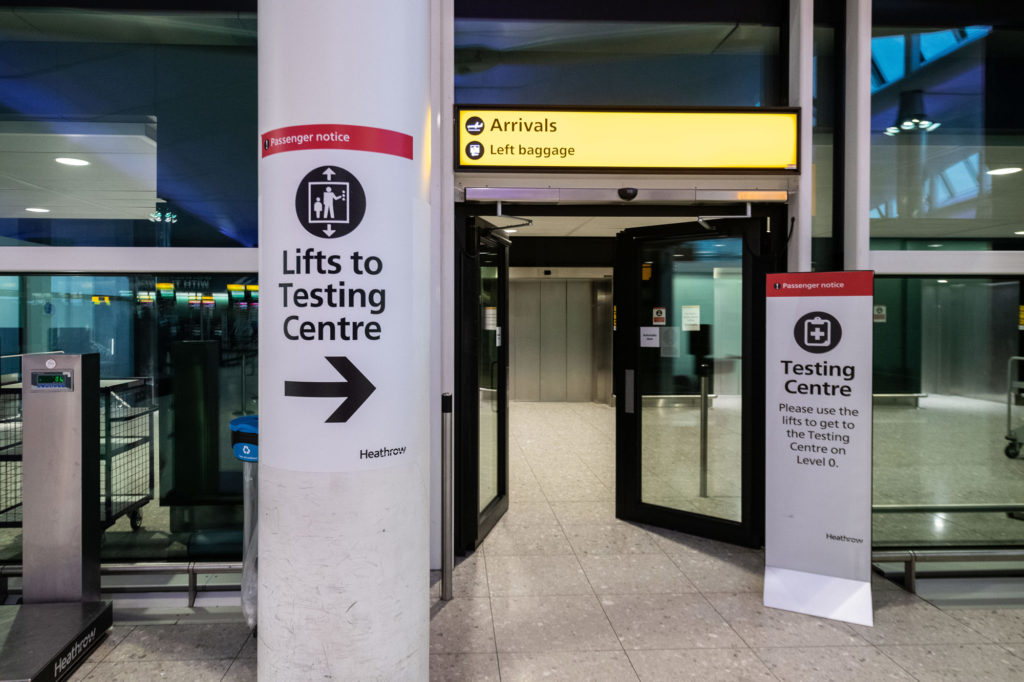 Signage leading to one of the testing centers at Heathrow Airport is seen on December 22, 2020 in London.