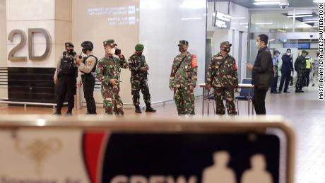 Indonesian military stand guard at Soekarno-Hatta International Airport in Jakarta after Sriwijaya Air flight 182 lost contact on Saturday.