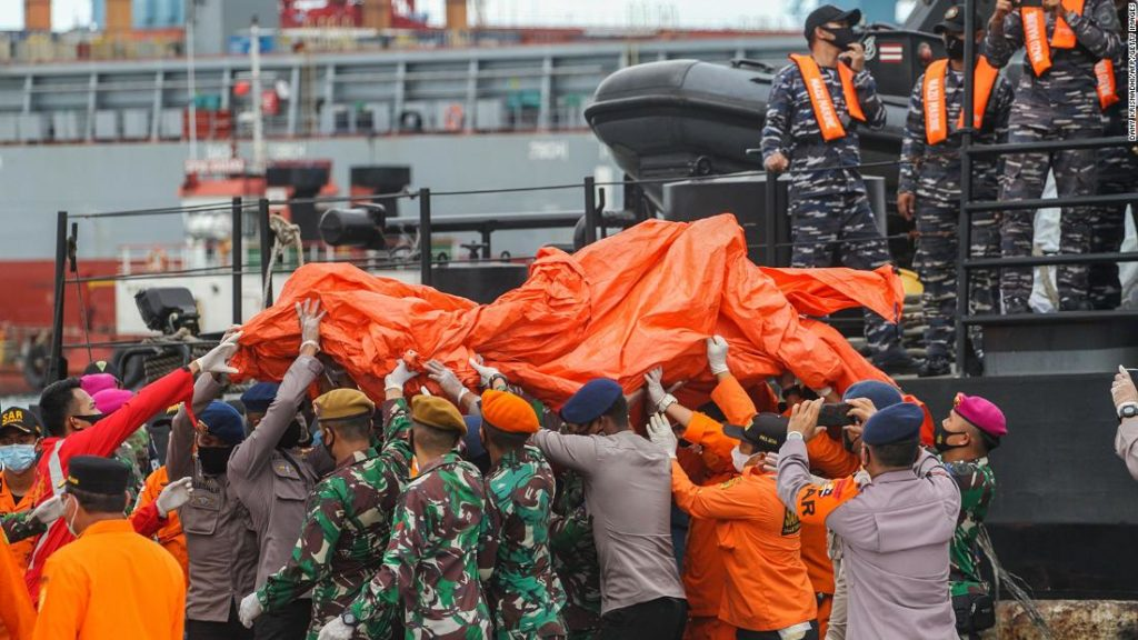 Indonesia plane crash: Black boxes located as human remains recovered
