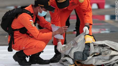 Rescuers inspects debris found in the waters around the location where a Sriwijaya Air passenger jet has lost contact, at the search and rescue command center at Tanjung Priok Port in Jakarta, on January 10, 2021.