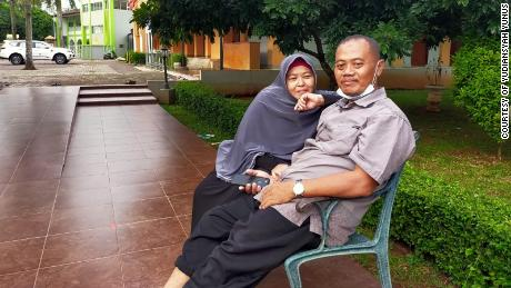 Married couple Muhammad Nur Kholifatul Amin, right, and Agus Minarni had traveled to Java to attend the funeral of Amin's father.