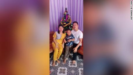Yohanes Suherdi, 30, poses with his wife, Susilawati Bungahilaria, and their 5-year-old son, Rian Gusti Rafael, in this Christmas portrait.