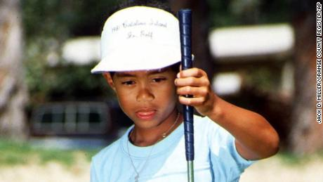 Six-year-old Eldrick 'Tiger' Woods sizes up a putt at Los Alamitos Country Club in Los Alamitos, Calif., in this Sept. 9, 1982 photo.