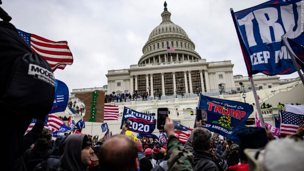 Pro-Trump supporters storm the US Capitol on January 6 following a rally with President Donald Trump.