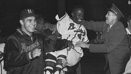 Aaron is carried from the field by his Milwaukee Braves teammates after they won the National League pennant in 1957.