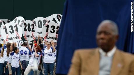 Fans hold up signs in the outfield with every home run hit by Aaron as he is honored on the 40th anniversary of his 715th on April 8, 2014, at Turner Field in Atlanta, Georgia.