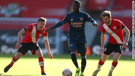 Arsenal's Nicolas Pepe is challenged by James Ward-Prowse (left) and Stuart Armstrong.
