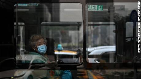 Face masks are one of the few remaining signs that point to Wuhan's past as the epicenter of a deadly pandemic.