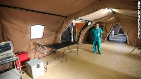 A medic walks around the coronavirus ward at the Italian field hospital at the Lebanese University campus in the town of Hadath in September 2020.